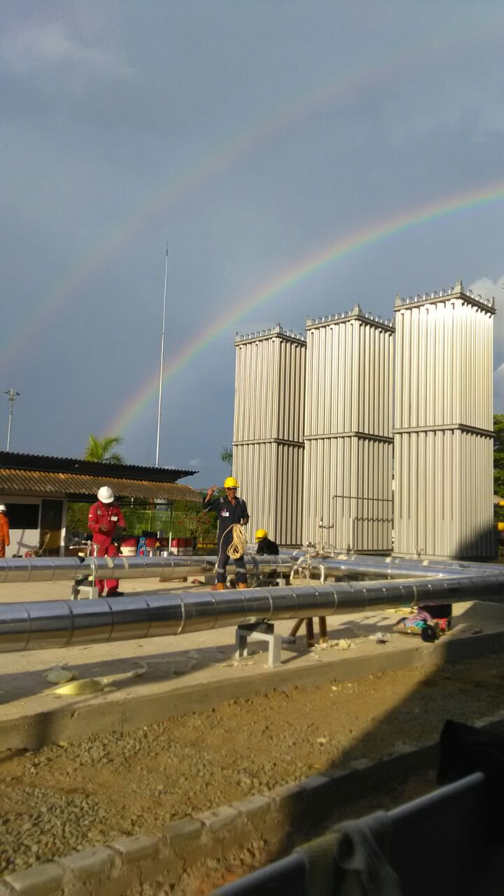 Beautiful Rainbow behind High Density Polyurethane Insulation Project